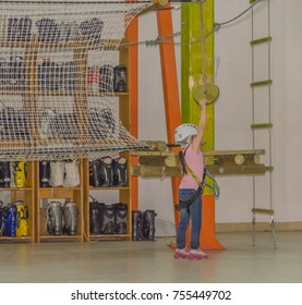 Russia, Saint-Petersburg, adventure Park, adventure Gornostay 27 Oct 2017 girl in the helmet and the insurance carries a swing