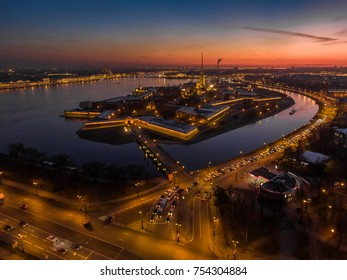 Russia, Saint-Petersburg, Aerial photo of Peter and Paul Fortress at sunset, cathedral, traffic, nightlights, illumination, clear weather, reflections, cityscape, landmark, Hermitage