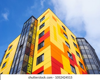 Russia. Saint-Petersburg. Gatchina. March 20, 2018. Modern beautiful new buildings. Colored wall on the background of blue sky.