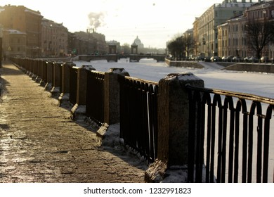 Russia, Saint-Petersburg, the Moyka river embankment .View of the Moyka in the ice. Romantic atmosphere, beautiful granite embankment , attractive for tourists.