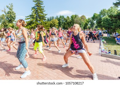 Russia, Samara, July 2017: young and beautiful girls and women are engaged in sports dancing on the Volga River Embankment on a summer sunny day.