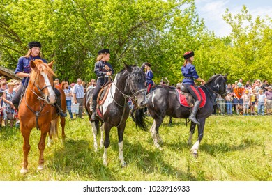 "Russia, Samara, June 2016: a demonstration of a Cossack girl on horseback for guests and spectators of the ""Journey to the Past"" festival, which is taking place near Samarah on Sunny Summer Day."
