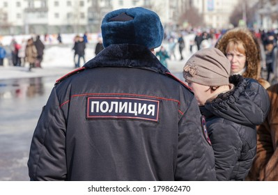 RUSSIA, SAMARA - March 2, 2014: Police patrol at the Shrovetide celebration. Maslenitsa or Pancake Week is the Slavic Holiday that dates back to the pagan times.