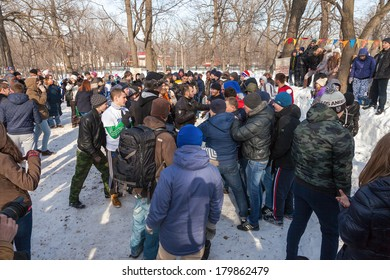 RUSSIA, SAMARA - March 2, 2014: Samara youth celebrates Shrovetide. Maslenitsa or Pancake Week is the only purely Slavic Holiday that dates back to the pagan times.