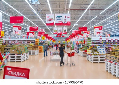 Russia, Samara, May 2019: The interior of the hypermarket Auchan. Text in Russian: discount price check canned