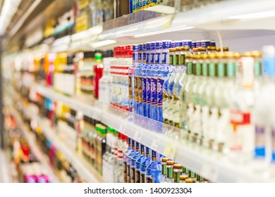 Russia, Samara, May 2019: a large selection of alcoholic beverages on the shelves of a supermarket.