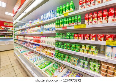 Russia, Samara, November 2018: dairy products on the store counter. Text in Russian: action, miracle, milk, sour cream, discount, oil
