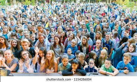 Russia Samara September 2017: Top view of a large dense crowd of spectators at a festival in the park.