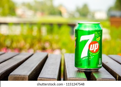 Russia, Sergiev Posad - July 21, 2018: Bank of 7up on a wooden bench