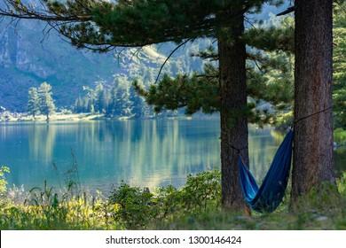 Russia, Siberia, Altay, Relax in hammock near lake