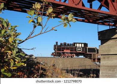 "Russia, Siberia, Krasnoyarsk region, Norilsk, Taimyr, Memorial to the ""First Builders of Norilsk"" on the Norilsk-Dudinka highway. Railway bridge and steam locomotive."