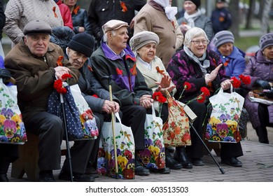 Russia. Siberia may 9, 2016. The celebration of victory day. Veterans on the street watching a concert of children.