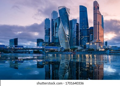 Russia. Skyscrapers in the center of Moscow. High-rise buildings in the capital of the Russia. Complex Moscow-city against the gray sky. Skyscrapers and a glazed bridge over the Moscow river.