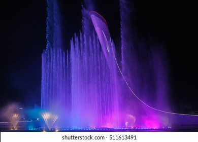 Russia, Sochi - 16 October 2016: Sochi Olympic Park, the Olympic flame bowl and a musical fountain, evening color-music show.
