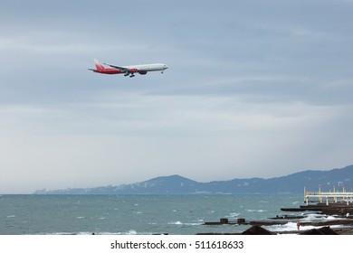 Russia, Sochi (Adler), passenger plane comes in to land on the Black Sea in Sochi airport.