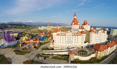 RUSSIA, SOCHI - JUL 27, 2014: Amusement park near hotel Bogatyr at summer sunny day. Aerial view. Photo with noise from action camera.