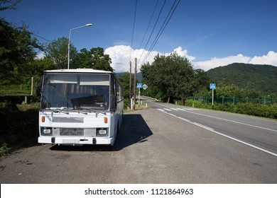 Russia, Sochi - June 9, 2018: Vintage bus near the road leading to the mountains