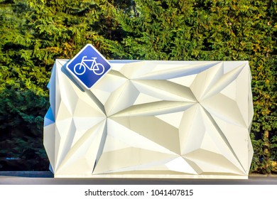 Russia, Sochi - November 18, 2017: A diamond-shaped bicycle sign hanging on a bicycle rental booth. In Sochi on a bicycle, you can spend the whole year