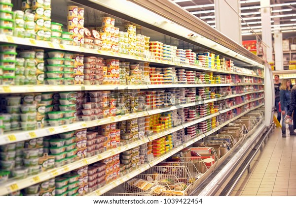 Russia, St. Petersburg, 07,12,2014 Shelves with cheese and cottage cheese in the supermarket