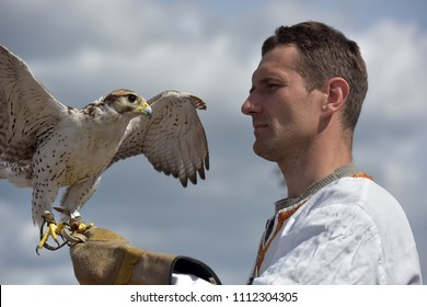 Russia, St. Petersburg, 10,06,2018 A man with a falcon on his hand in Slavic national clothes at the festival of Slavic culture, timed to celebrate the Day of Russia