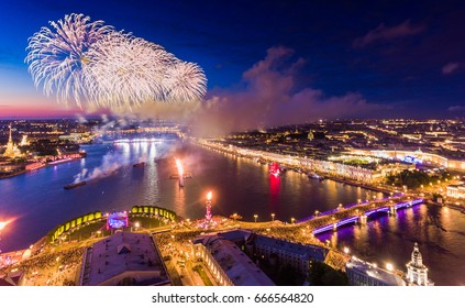 Russia, St. Petersburg, 23 June 2017: Aerial view of Fireworks at SCARLET SAILS holiday, Neva river, Palace Bridge, fire on Rostral colomns, a lot of people on old stock exchange square, fortress