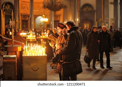 Russia, St. Petersburg 24,03,2013 Believers in an Orthodox church put candles and pray