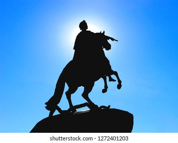 Russia, St. Petersburg, architecture. Monument to Peter The Great. Silhouette of the Bronze Horseman against the clear blue sky. The sun behind head of horseman the rider forms a halo.