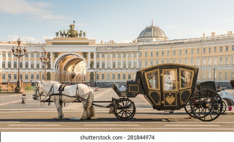 Russia, St. Petersburg City, Tsar Horse Carriage in front of Winter Palace Landmark Tourist Attraction at sunset in summer daytime, Hermitage Museum, Palace square