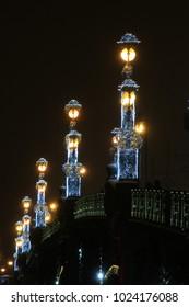 Russia, St. Petersburg, the lanterns of the Trinity Bridge in the dark