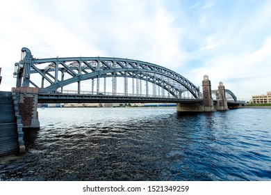 Russia St. Petersburg Neva river morning day evening night sunset dawn during winter summer spring autumn Bolsheokhtinsky bridge of Peter the Great reflected in water, clouds and blue sky