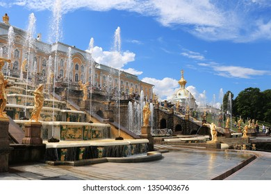 Russia, St. Petersburg, Peterhof, July 4, 2018. On the photo is the Grand Cascade fountain in the Upper Park of the Peterhof State Museum and people who walk in the park
