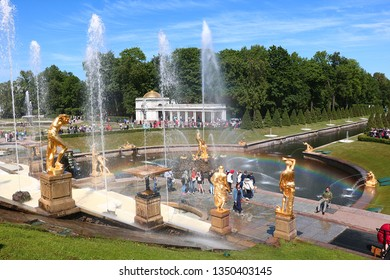 Russia, St. Petersburg, Peterhof, June 8, 2018. On the photo is the Grand Cascade fountain in the Upper Park of the Peterhof State Museum and people who walk in the park