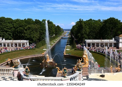 Russia, St. Petersburg, Peterhof, June 2, 2018. On the photo is the Grand Cascade fountain in the Upper Park of the Peterhof State Museum and people who walk in the park
