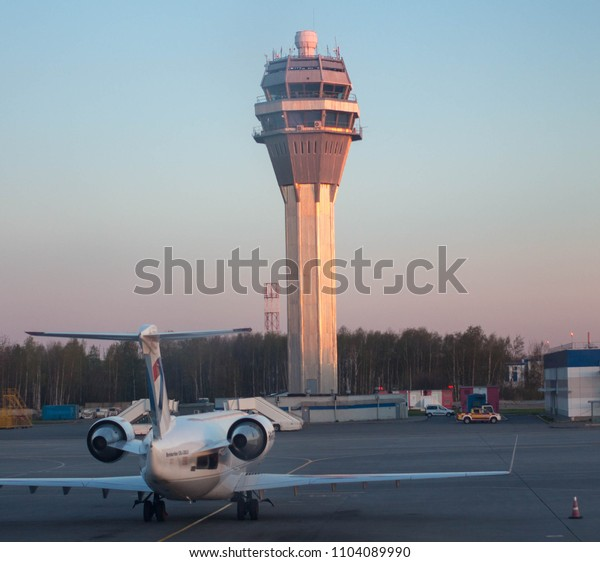 Russia, St.Petersburg, 05.09.18: Airport window view at sun rise, airplane and building structures, travel and tourism