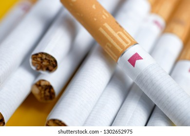 RUSSIA, ST.PETERSBURG -  31, January 2019: Cigarettes of red marborough lie on a yellow background. Close up.