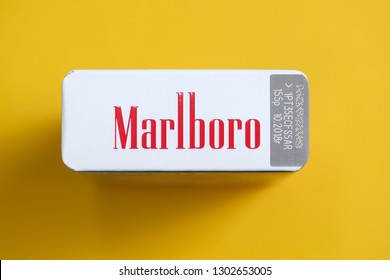 RUSSIA, ST.PETERSBURG -  31, January 2019: A pack of cigarettes of red marlboro on a yellow background. Top View.