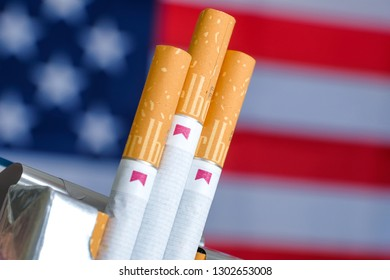 RUSSIA, ST.PETERSBURG -  31, January 2019: Red pack with Marlboro cigarettes on the background of the USA flag.