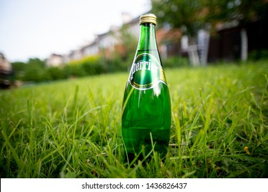 RUSSIA, ST.PETERSBURG 8 june 2019: Perrier Naturally Sparkling Water outside in the summer garden. Perrier is a French brand.