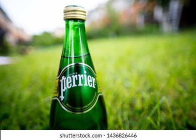 RUSSIA, ST.PETERSBURG 8 june 2019: Perrier Naturally Sparkling Water outside in the summer garden. Perrier is a French brand. Close up.