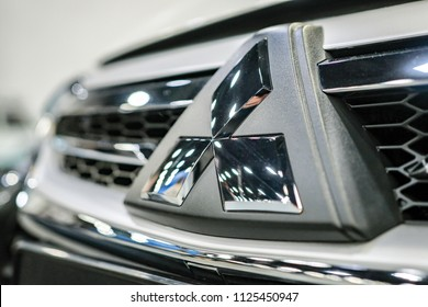 RUSSIA, ST.PETERSBURG - june 6, 2018: Mitsubishi Motors logo  on the radiator grille close up