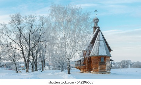 Russia, Suzdal. Classic winter landscape: trees in frost and a wooden Nikolskaya Church in Suzdal Kremlin.