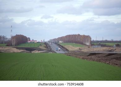 Russia, Tambov region, near the village Rgaksa, horizon, nature, autumn, day, trucks, green grass, November 2, 2017