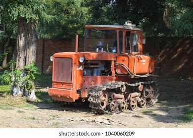 Russia, Temryuk - 15 July 2015: Tractor, standing in a row. Agricultural machinery. Parking of agricultural machinery
