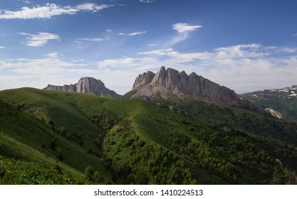 Russia, timelapse. The formation and movement of clouds over the summer slopes of Adygea Bolshoy Thach and the Caucasus Mountains