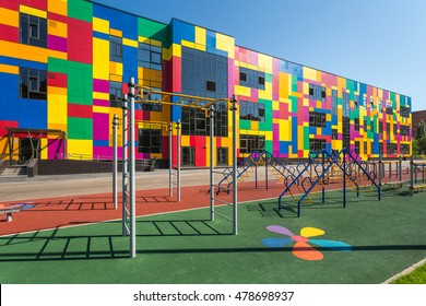 Russia, Togliatti - August 30, 2016: Modern school building with lawn. Exterior of new city school with sports area and garden