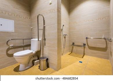 Russia, Togliatti - August 30, 2016: Inside in school building. New school for children. Interior of beautiful public toilet. Public restroom for disabled people