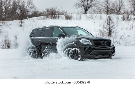 Russia, Togliatti - DECEMBER 25, 2016: Snow test drive of Mercedes GL and GLS with tuning kit Black Crystal of LARTE Design Tuning Company. Luxury SUV in deep snow and various weather conditions