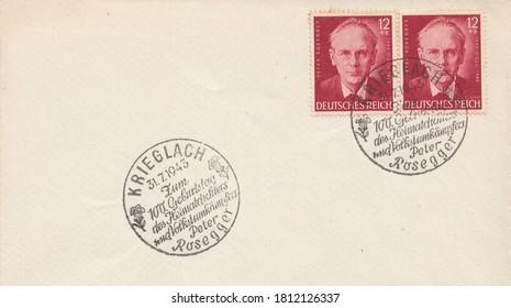 RUSSIA - TOPKI, September 10, 2020: A stamp printed in Deutsches Reich, shows Portrait of the Austrian writer Peter Rosegger. Postmark of Krieglach, circa 1943
