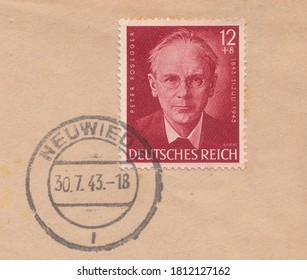 RUSSIA - TOPKI, September 10, 2020: A stamp printed in Deutsches Reich, shows Portrait of the Austrian writer Peter Rosegger. Postmark of Neuwied, circa 1943