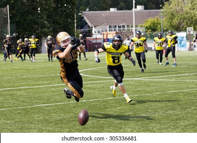RUSSIA, TROITSK CITY - JULY 11: Alexeev Grigoriy (48) in action on Russian american football Championship game Spartans vs Raiders 52 on July 11, 2015, in Moscow region, Troitsk city, Russia